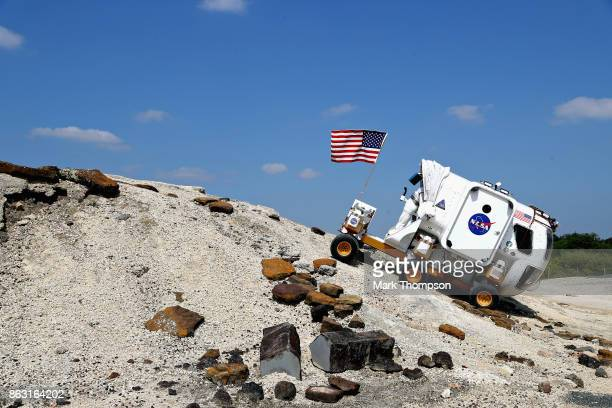 Daniel Ricciardo of Australia and Red Bull Racing and Max Verstappen of Netherlands and Red Bull Racing drive in a NASA Moon Rover during previews...