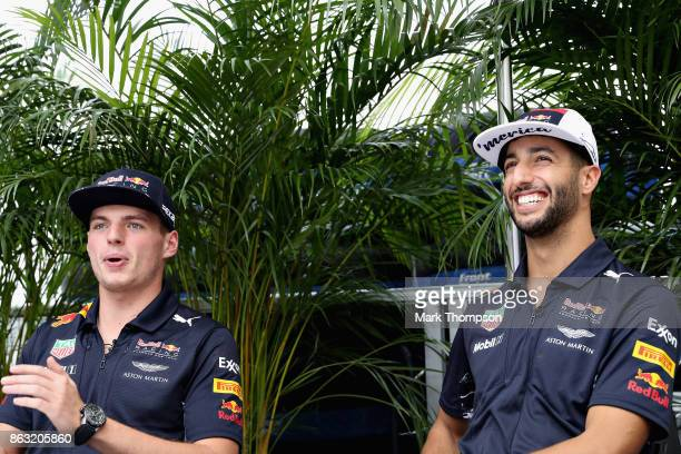 Daniel Ricciardo of Australia and Red Bull Racing and Max Verstappen of Netherlands and Red Bull Racing talk in the Paddock during previews ahead of...