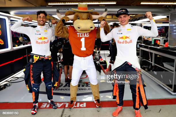 Daniel Ricciardo of Australia and Red Bull Racing and Max Verstappen of Netherlands and Red Bull Racing pose for a photo with Texas Longhorns mascot...