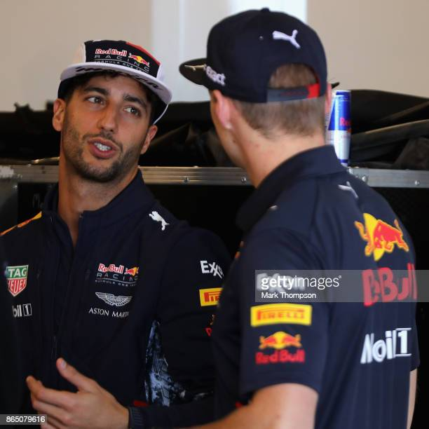 Daniel Ricciardo of Australia and Red Bull Racing and Max Verstappen of Netherlands and Red Bull Racing talk before the United States Formula One...