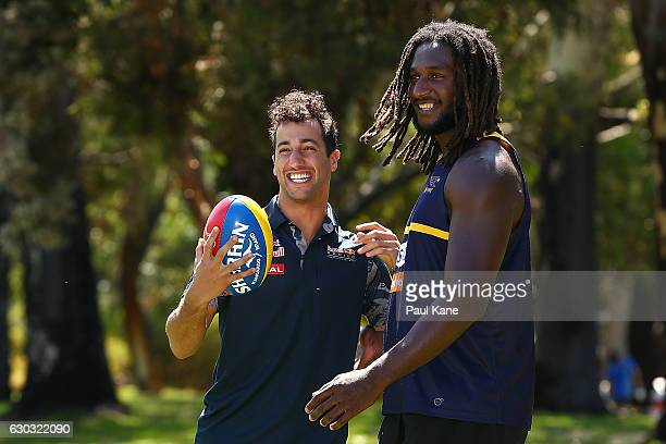 Daniel Ricciardo of Australia and Red Bull Racing and Nic Naitanui of the West Coast Eagles play with the football during a West Coast Eagles AFL...