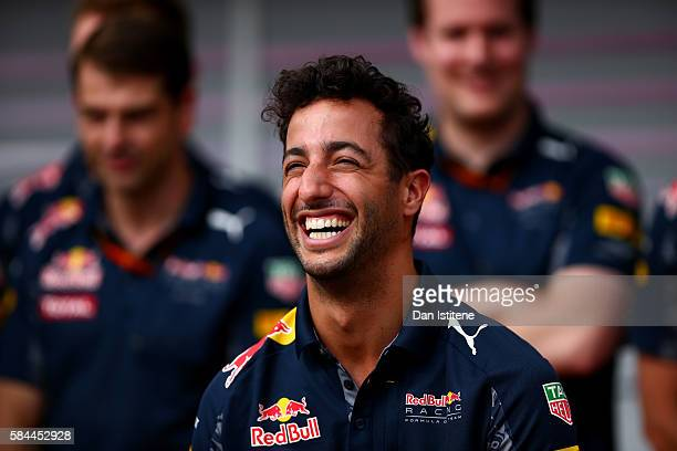 Daniel Ricciardo of Australia and Red Bull Racing and the Red Bull Racing team celebrate for Daniel's 100th F1 Grand Prix during previews to the...