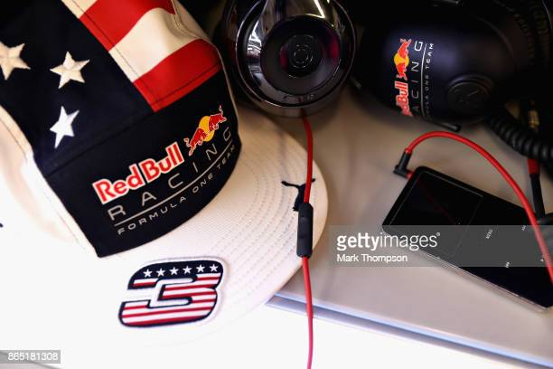 Daniel Ricciardo of Australia and Red Bull Racing cap in the Red Bull Racing garage before the United States Formula One Grand Prix at Circuit of The...