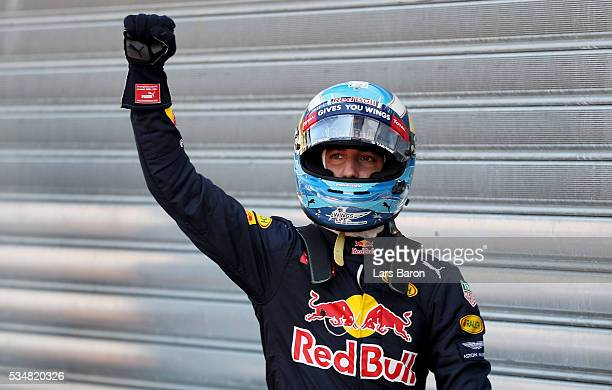 Daniel Ricciardo of Australia and Red Bull Racing celebrates getting pole position in parc ferme during qualifying for the Monaco Formula One Grand...