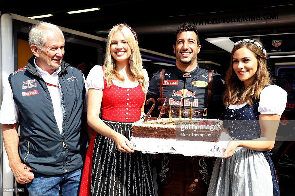 <a gi-track='captionPersonalityLinkClicked' href=/galleries/search?phrase=Daniel+Ricciardo&family=editorial&specificpeople=6547569 ng-click='$event.stopPropagation()'>Daniel Ricciardo</a> of Australia and Red Bull Racing celebrates his 27th birthday with a cake, Red Bull Racing Team Consultant Dr <a gi-track='captionPersonalityLinkClicked' href=/galleries/search?phrase=Helmut+Marko&family=editorial&specificpeople=1692282 ng-click='$event.stopPropagation()'>Helmut Marko</a> and a couple of girls dressed in traditional Austrian dirndl dresses before practice for the Formula One Grand Prix of Austria at Red Bull Ring on July 1, 2016 in Spielberg, Austria.