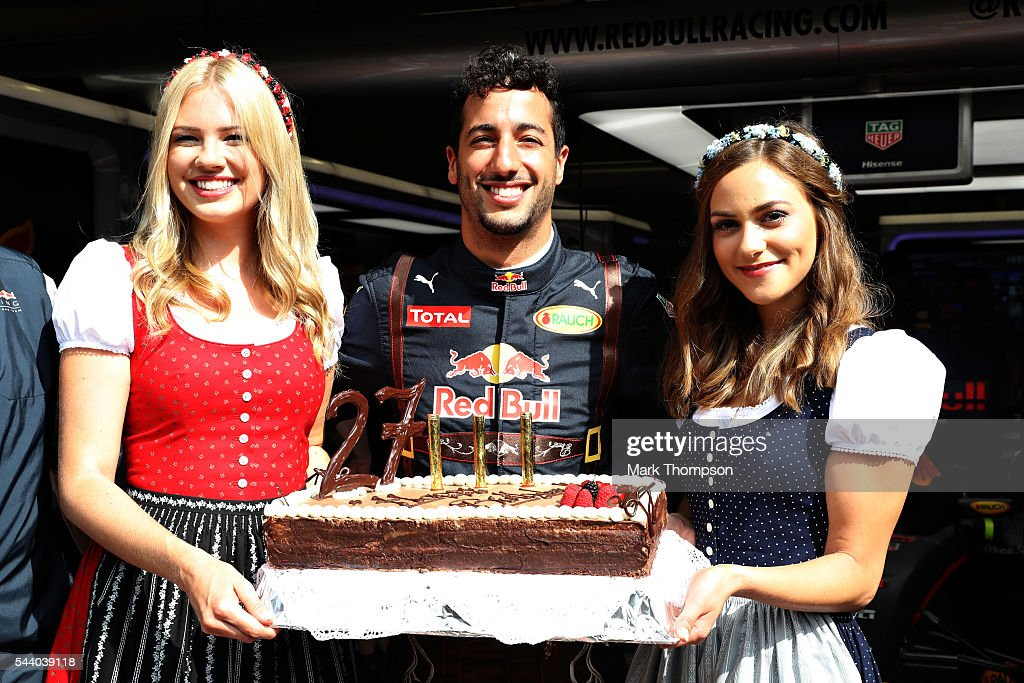 <a gi-track='captionPersonalityLinkClicked' href=/galleries/search?phrase=Daniel+Ricciardo&family=editorial&specificpeople=6547569 ng-click='$event.stopPropagation()'>Daniel Ricciardo</a> of Australia and Red Bull Racing celebrates his 27th birthday with a cake and a couple of girls dressed in traditional Austrian dirndl dresses before practice for the Formula One Grand Prix of Austria at Red Bull Ring on July 1, 2016 in Spielberg, Austria.
