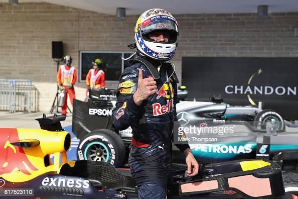 Daniel Ricciardo of Australia and Red Bull Racing celebrates finishing in third place in parc ferme during the United States Formula One Grand Prix...