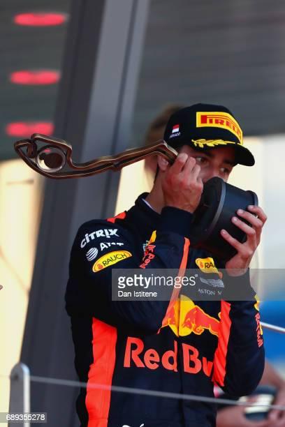 Daniel Ricciardo of Australia and Red Bull Racing celebrates finishing in third position on the podium during the Monaco Formula One Grand Prix at...
