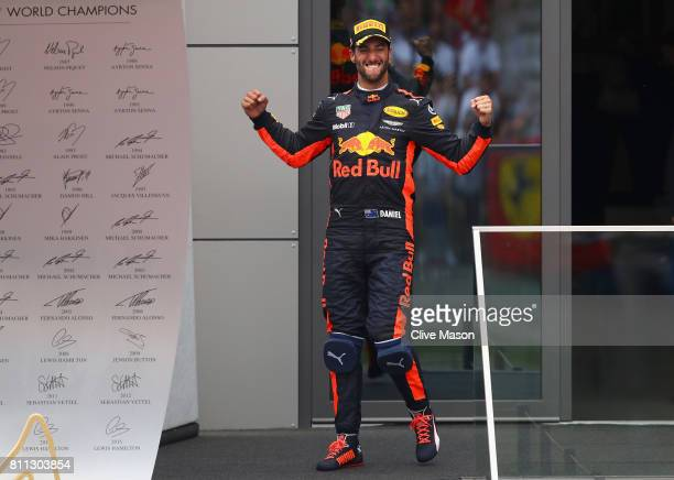 Daniel Ricciardo of Australia and Red Bull Racing celebrates finishing in third place on the podium during the Formula One Grand Prix of Austria at...