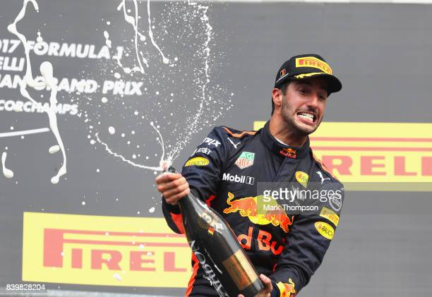 Daniel Ricciardo of Australia and Red Bull Racing celebrates finishing in third place on the podium during the Formula One Grand Prix of Belgium at...