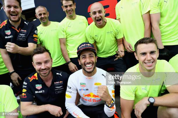 Daniel Ricciardo of Australia and Red Bull Racing celebrates finishing in third position with his team during the Formula One Grand Prix of Austria...
