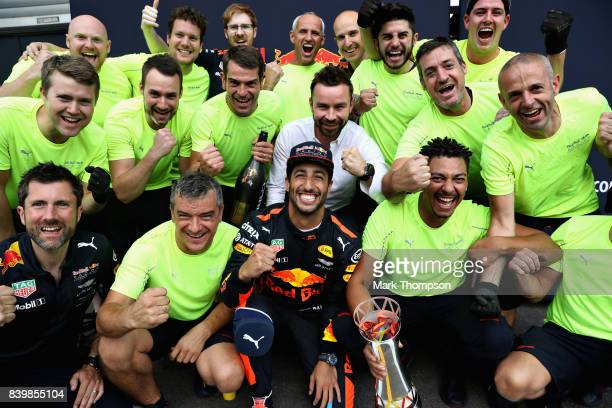 Daniel Ricciardo of Australia and Red Bull Racing celebrates finishing in third place with his team after the Formula One Grand Prix of Belgium at...