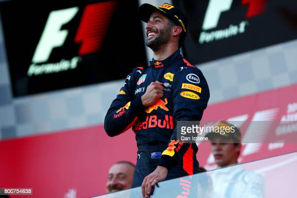 Daniel Ricciardo of Australia and Red Bull Racing celebrates on the podium after winning the Azerbaijan Formula One Grand Prix at Baku City Circuit...