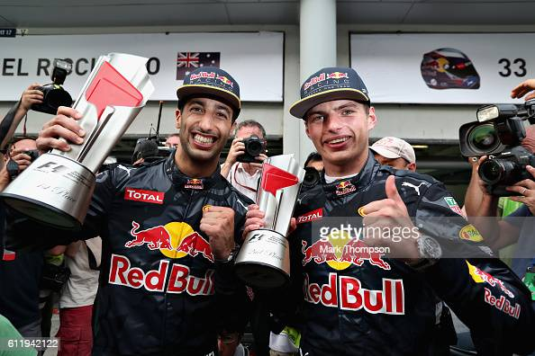 Daniel Ricciardo of Australia and Red Bull Racing celebrates with Max Verstappen of Netherlands and Red Bull Racing after their 12 finish during the...