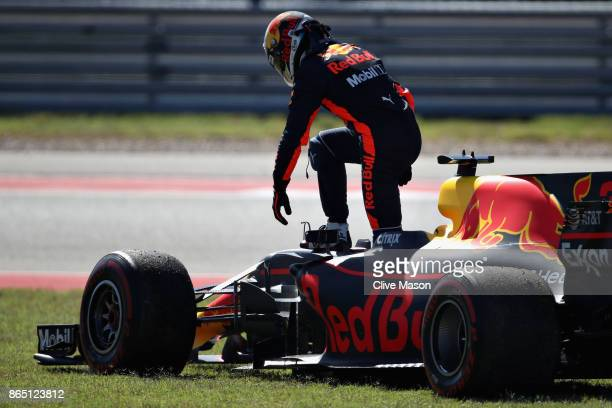 Daniel Ricciardo of Australia and Red Bull Racing climbs from his car after retiring during the United States Formula One Grand Prix at Circuit of...