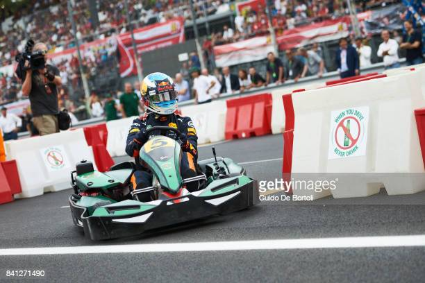 Daniel Ricciardo of Australia and Red Bull Racing drives a gokart during the Heineken Champions of the Grid gokart race ahead of the Formula One...