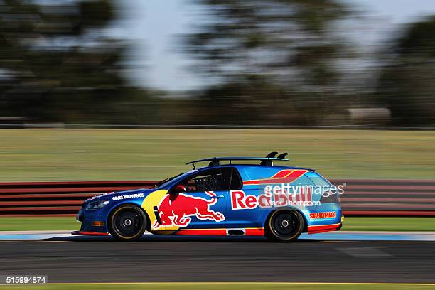 Daniel Ricciardo of Australia and Red Bull Racing drives the Holden Sandman car during previews to the Australian Formula One Grand Prix at Sandown...