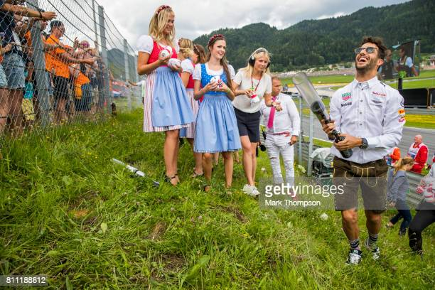Daniel Ricciardo of Australia and Red Bull Racing engages with the fans on the drivers parade before the Formula One Grand Prix of Austria at Red...