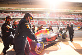 Daniel Ricciardo of Australia and Red Bull Racing is pushed back into the garage during day two of F1 winter testing at Circuit de Catalunya on March...