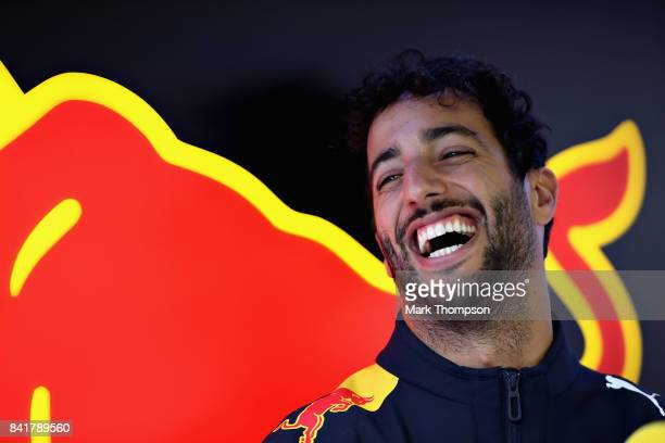 Daniel Ricciardo of Australia and Red Bull Racing laughs in the garage during final practice for the Formula One Grand Prix of Italy at Autodromo di...