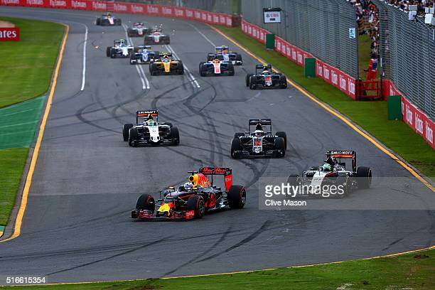 Daniel Ricciardo of Australia and Red Bull Racing leads Nico Hulkenberg of Germany and Force India and Fernando Alonso of Spain and McLaren Honda...