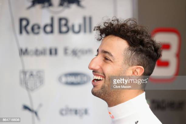 Daniel Ricciardo of Australia and Red Bull Racing looks on in the garage during final practice for the United States Formula One Grand Prix at...