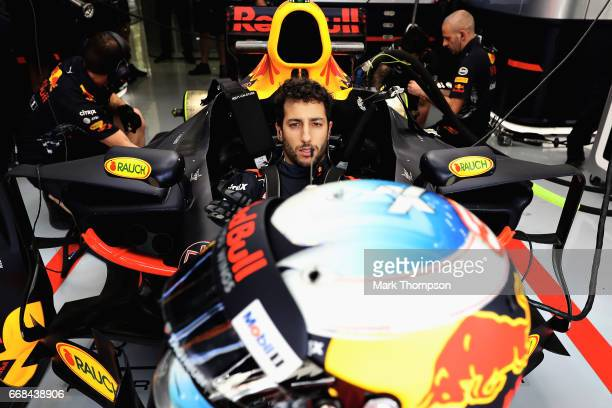 Daniel Ricciardo of Australia and Red Bull Racing prepares to drive in the garage during practice for the Bahrain Formula One Grand Prix at Bahrain...