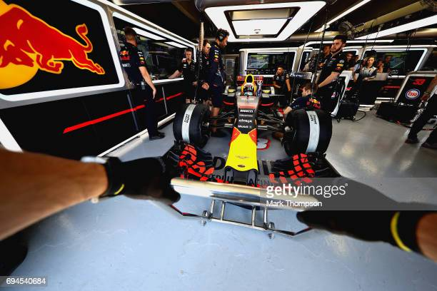 Daniel Ricciardo of Australia and Red Bull Racing prepares to drive in the garage during qualifying for the Canadian Formula One Grand Prix at...