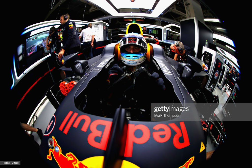 Daniel Ricciardo of Australia and Red Bull Racing prepares to drive in the garage during practice for the Formula One Grand Prix of Japan at Suzuka Circuit on October 6, 2017 in Suzuka.