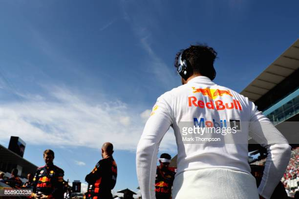 Daniel Ricciardo of Australia and Red Bull Racing prepares to drive on the grid before the Formula One Grand Prix of Japan at Suzuka Circuit on...