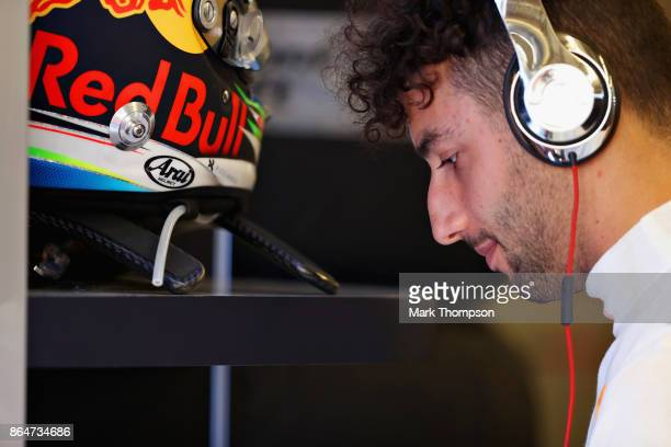 Daniel Ricciardo of Australia and Red Bull Racing prepares to drive in the garage before qualifying for the United States Formula One Grand Prix at...