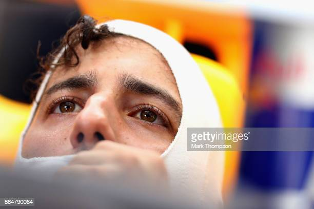 Daniel Ricciardo of Australia and Red Bull Racing prepares to drive in the garage during qualifying for the United States Formula One Grand Prix at...