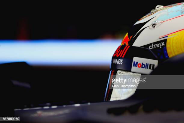 Daniel Ricciardo of Australia and Red Bull Racing prepares to drive in the garage during qualifying for the Formula One Grand Prix of Mexico at...