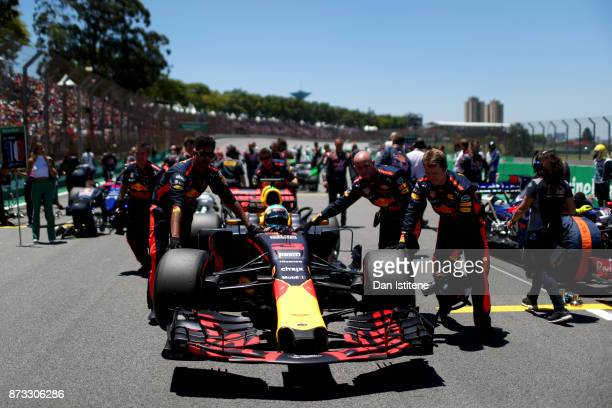 Daniel Ricciardo of Australia and Red Bull Racing prepares to drive on the grid before the Formula One Grand Prix of Brazil at Autodromo Jose Carlos...
