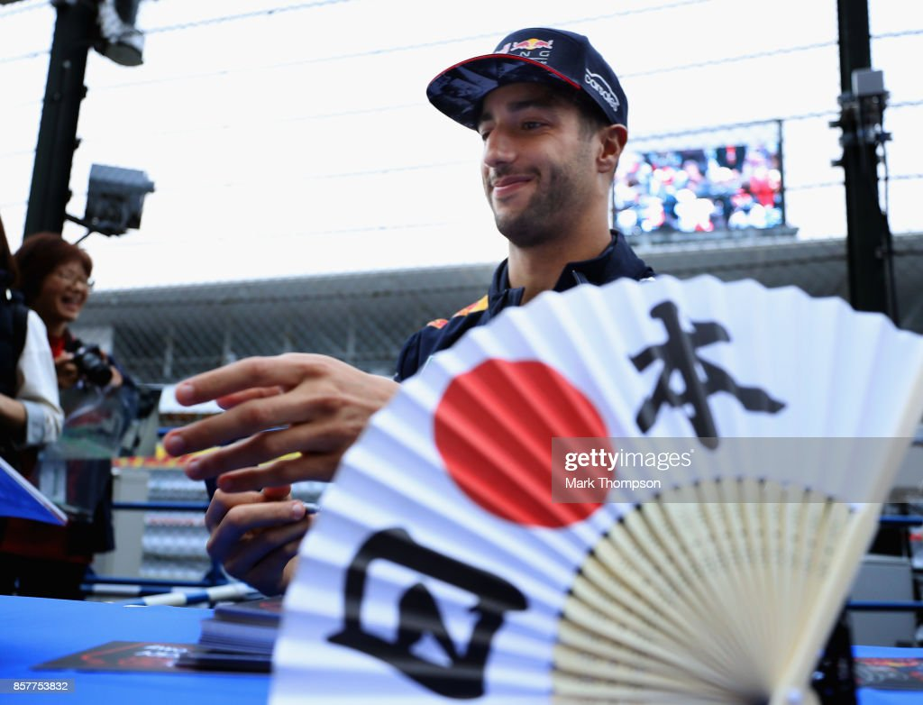 Daniel Ricciardo of Australia and Red Bull Racing signs autographs for fans during previews ahead of the Formula One Grand Prix of Japan at Suzuka Circuit on October 5, 2017 in Suzuka.