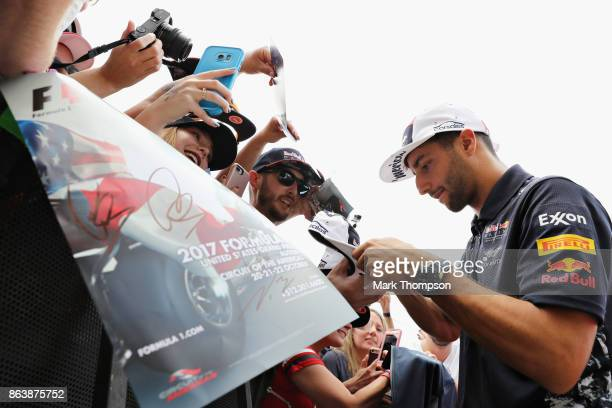 Daniel Ricciardo of Australia and Red Bull Racing signs autographs for fans between practice for the United States Formula One Grand Prix at Circuit...