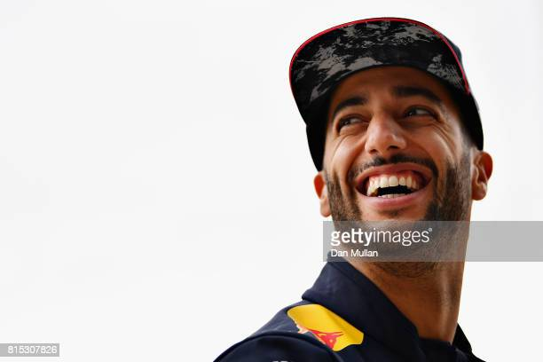 Daniel Ricciardo of Australia and Red Bull Racing smiles in the Paddock before the Formula One Grand Prix of Great Britain at Silverstone on July 16...