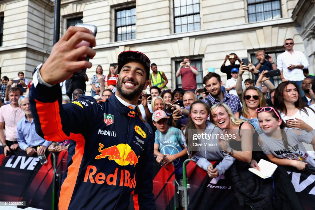 Daniel Ricciardo of Australia and Red Bull Racing takes a selfie with fans during F1 Live London at Trafalgar Square on July 12, 2017 in London, England. F1 Live London, the first time in Formula 1 history that all 10 teams come together outside of a race weekend to put on a show for the public in the heart of London.
