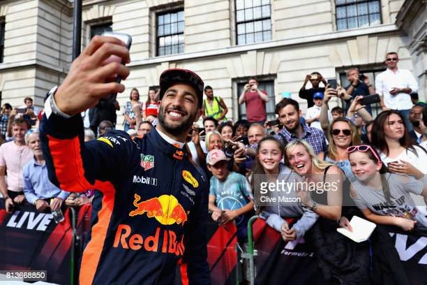 Daniel Ricciardo of Australia and Red Bull Racing takes a selfie with fans during F1 Live London at Trafalgar Square on July 12 2017 in London...