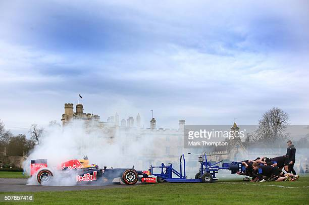 Daniel Ricciardo of Australia and Red Bull Racing takes part in a 'F1 vs Rugby Scrum' event with members of the Bath rugby squad at the Bath training...