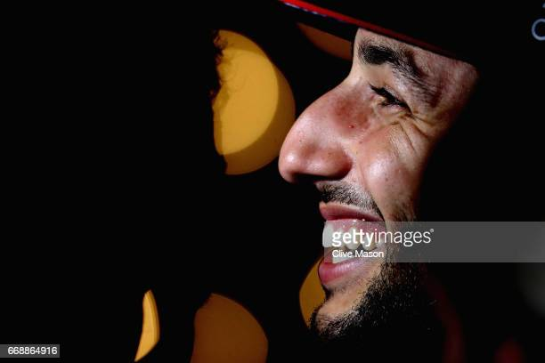 Daniel Ricciardo of Australia and Red Bull Racing talks to the media after qualifying for the Bahrain Formula One Grand Prix at Bahrain International...