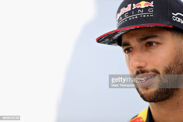 Daniel Ricciardo of Australia and Red Bull Racing talks to the media in the Paddock during previews for the Canadian Formula One Grand Prix at...