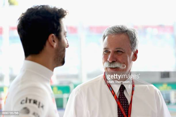 Daniel Ricciardo of Australia and Red Bull Racing talks with Chase Carey CEO and Executive Chairman of the Formula One Group in the Red Bull Racing...