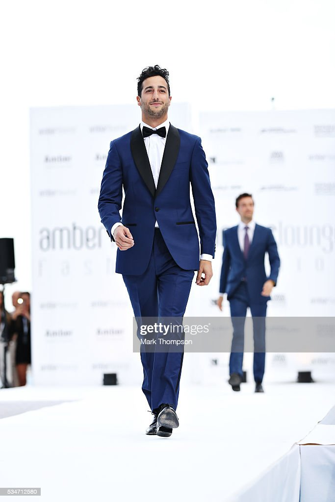 Daniel Ricciardo of Australia and Red Bull Racing walks the catwalk during the Amber Lounge fashion show during previews to the Monaco Formula One Grand Prix at Circuit de Monaco on May 27, 2016 in Monte-Carlo, Monaco.