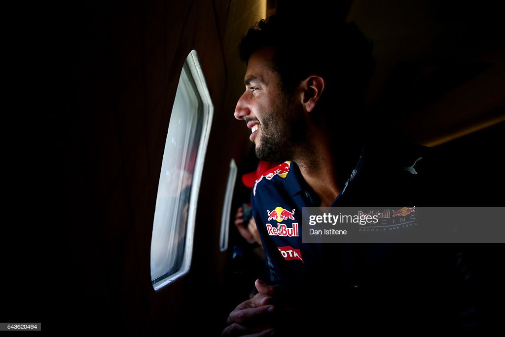<a gi-track='captionPersonalityLinkClicked' href=/galleries/search?phrase=Daniel+Ricciardo&family=editorial&specificpeople=6547569 ng-click='$event.stopPropagation()'>Daniel Ricciardo</a> of Australia and Red Bull Racing watches Red Bull Air Race pilot Hannes Arch fly next to the Red Bull Douglas DC-6B during a Red Bull Racing media flight to Hangar 7 on June 29, 2016 in flight over Austria.