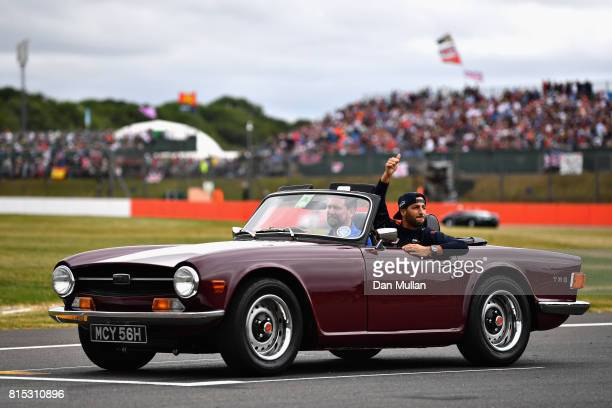 Daniel Ricciardo of Australia and Red Bull Racing waves to the crowd on the drivers parade before the Formula One Grand Prix of Great Britain at...