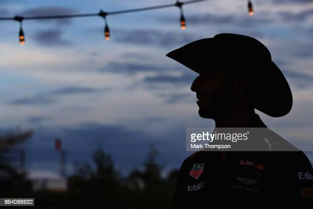 Daniel Ricciardo of Australia and Red Bull Racing wears a cowboy hat after practice for the United States Formula One Grand Prix at Circuit of The...