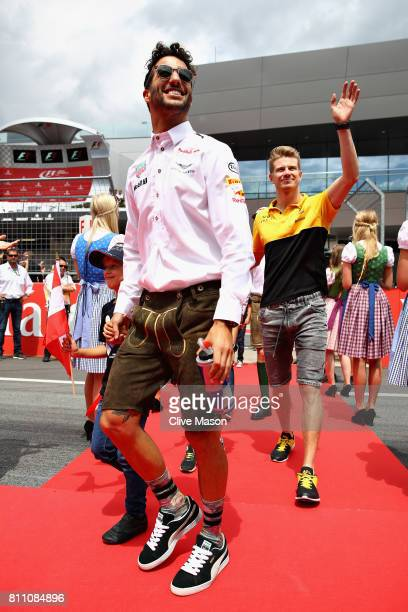 Daniel Ricciardo of Australia and Red Bull Racing wears lederhosen on the drivers parade before the Formula One Grand Prix of Austria at Red Bull...