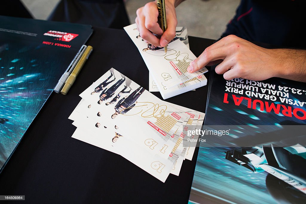 Daniel Ricciardo of Australia and Scuderia Toro Rosso signs autographs for fans before the Malaysian Formula One Grand Prix at the Sepang Circuit on March 24, 2013 in Kuala Lumpur, Malaysia.