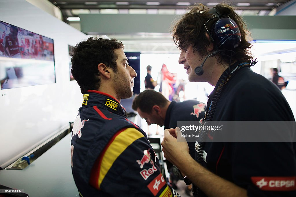 Daniel Ricciardo of Australia and Scuderia Toro Rosso speaks with Marco Matassa his Scuderia Toro Rosso Race Engineer during practice for the Malaysian Formula One Grand Prix at the Sepang Circuit on March 22, 2013 in Kuala Lumpur, Malaysia.
